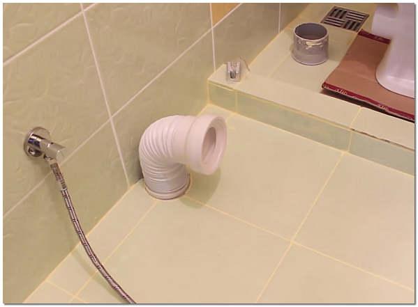 Подсоединение гофрированного слива для унитаза к канализации